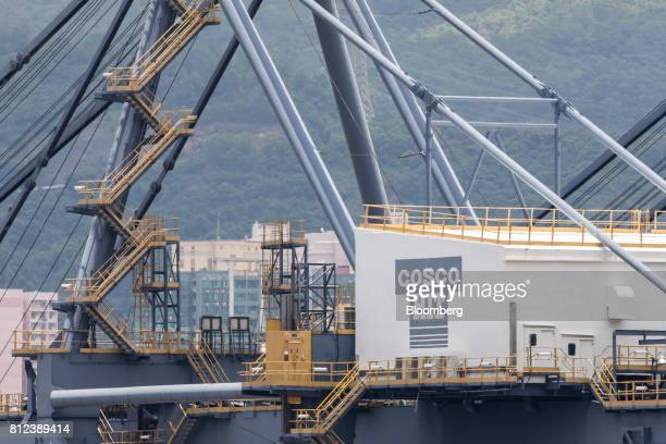 The logo for COSCOHIT Terminals Ltd a unit of Cosco Shipping Holdings Co is displayed on a crane at the Kwai Tsing Container Terminal in Hong Kong...