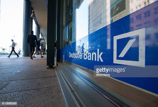 The logo for Deutsche Bank AG sits on the exterior of a bank branch in Berlin Germany on Tuesday Sept 27 2016 Deutsche Bank AG rose in Frankfurt...