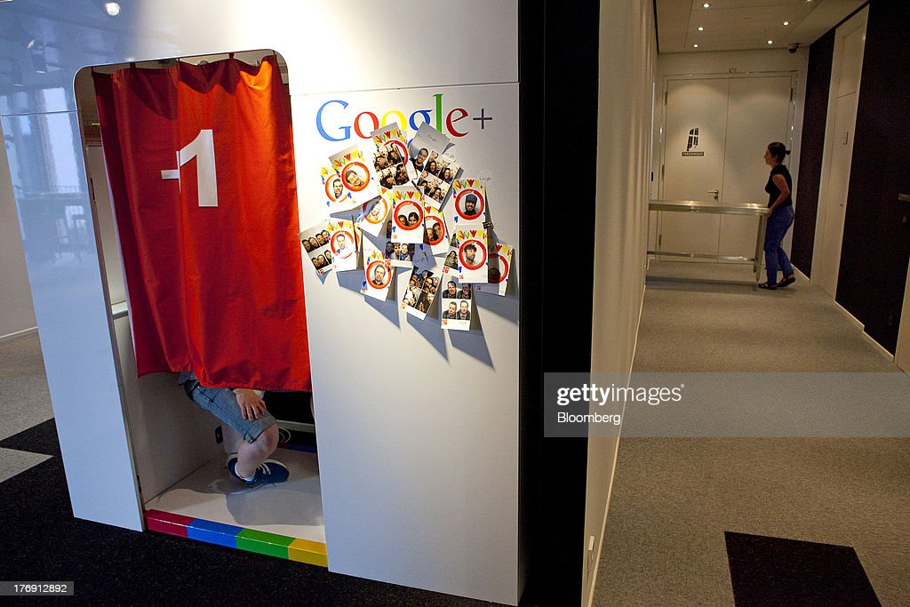 The logo for Google Inc.'s Google Plus social networking product sits outside a photo booth inside the company's offices in Berlin, Germany, on Friday, Aug. 16, 2013. Google, based in Mountain View, California, is seeking to revive Motorola Mobility's smartphone business, recently announcing a new flagship Moto X smartphone with customizable colors that will be assembled in the U.S. Photographer: Krisztian Bocsi/Bloomberg via Getty Images