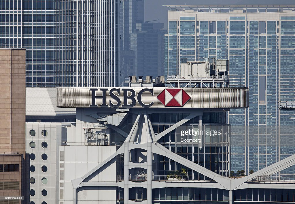 The logo for HSBC Holdings Plc is displayed atop the company's headquarters in the business district of Central in Hong Kong, China, on Thursday, Dec. 29, 2011. Hong Kong stocks fell today after a surge in lending by the European Central Bank underscored the scale of the region's debt crisis. Photographer: Jerome Favre/Bloomberg via Getty Images