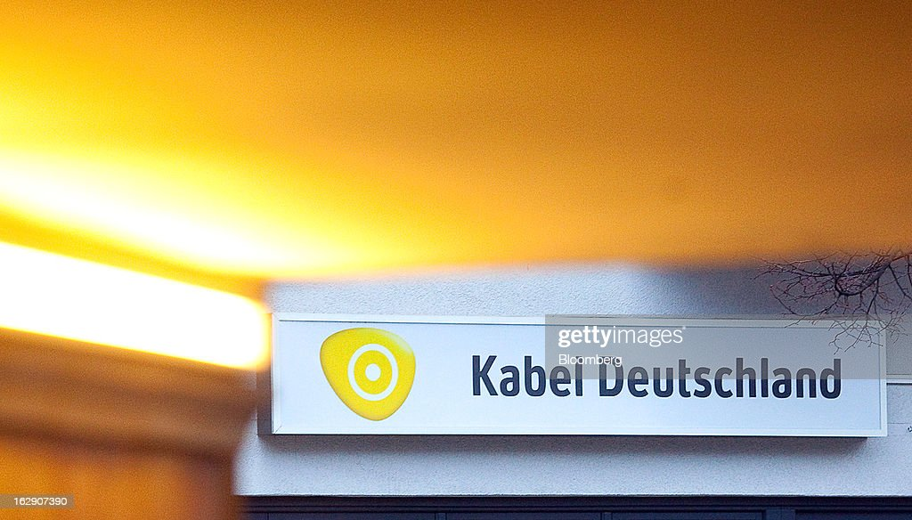 The logo for Kabel Deutschland, operated by Kabel Deutschland Holding AG, the German cable operator is seen displayed above a store in Berlin, Germany, on Friday, March 1, 2013. Vodafone Group Plc has put on hold plans to approach Kabel Deutschland Holding AG about a takeover bid after leaks of a potential offer complicated internal discussions, according to three people familiar with the matter. Photographer: Krisztian Bocsi/Bloomberg via Getty Images