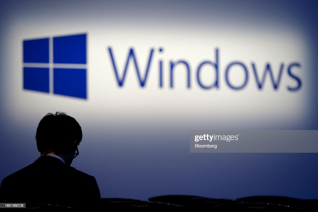 The logo for Microsoft Corp.'s Windows operating system is displayed at a launch event for the Windows 8.1 operating system in Tokyo, Japan, on Friday, Oct. 18, 2013. Microsoft Chief Executive Officer Steve Ballmer, who will be retiring within a year, said the company is still working to make sure that the personal computer remains relevant as 'the device of choice.' Photographer: Kiyoshi Ota/Bloomberg via Getty Images