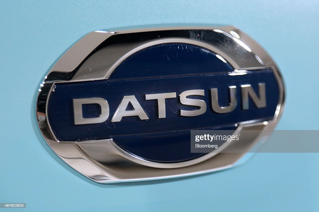The logo for Nissan Motor Co.'s Datsun brand is seen on a Datsun Go automobile at the company's showroom in Yokohama, Japan on Wednesday, Jan. 8, 2014. Nissan said its low-end Datsun business will generate operating margins of as high as 7 percent because of its no-frills designs and by sharing the parents development facilities and distribution network. Photographer: Yuriko Nakao/Bloomberg via Getty Images