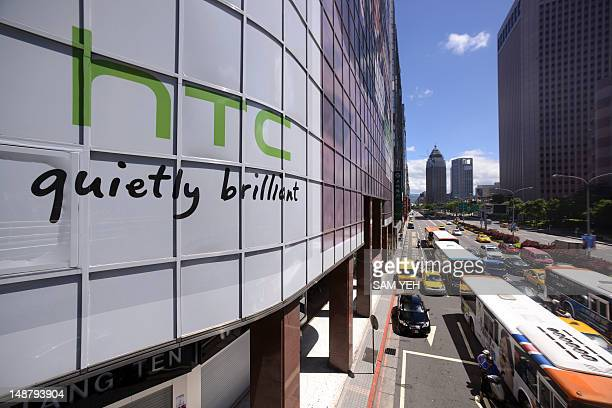 The logo for Taiwan's leading smartphone maker HTC is pictured above a busy street in Taipei on July 20 2012 Taiwan's leading smartphone maker HTC...