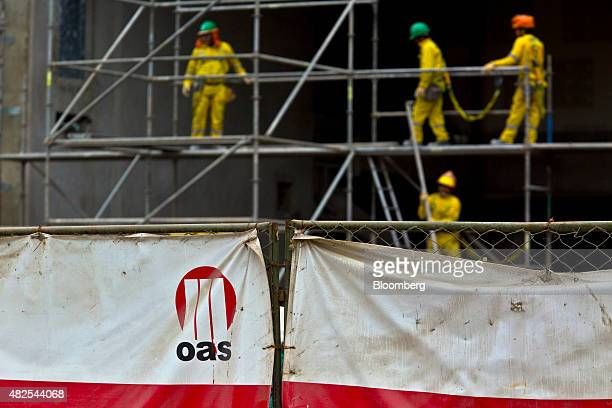 The logo for the Brazilian builder OAS SA hangs from a banner during construction of the Banco de la Nacion state bank headquarters building in the...