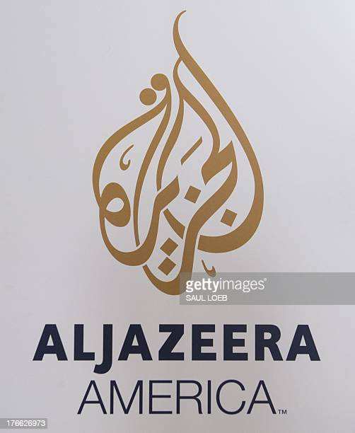 The logo for the cable news network Al Jazeera America appears outside the network's studio space at the Newseum in Washington DC August 16 2013 Al...