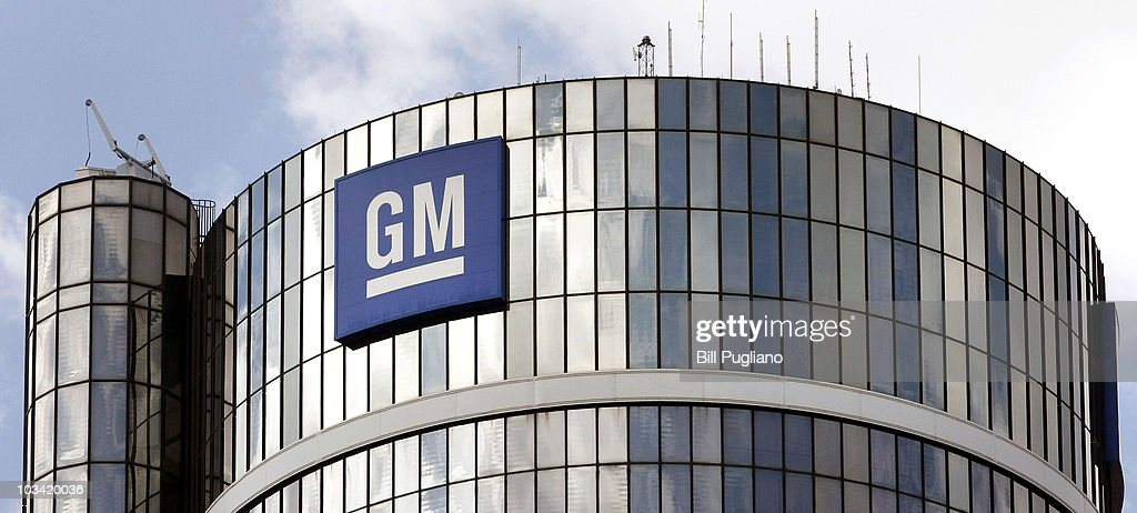 The logo for the General Motors Company is seen at the top of its World Headquarters and Renaissance Center complex is seen August 17 2010 in Detroit...
