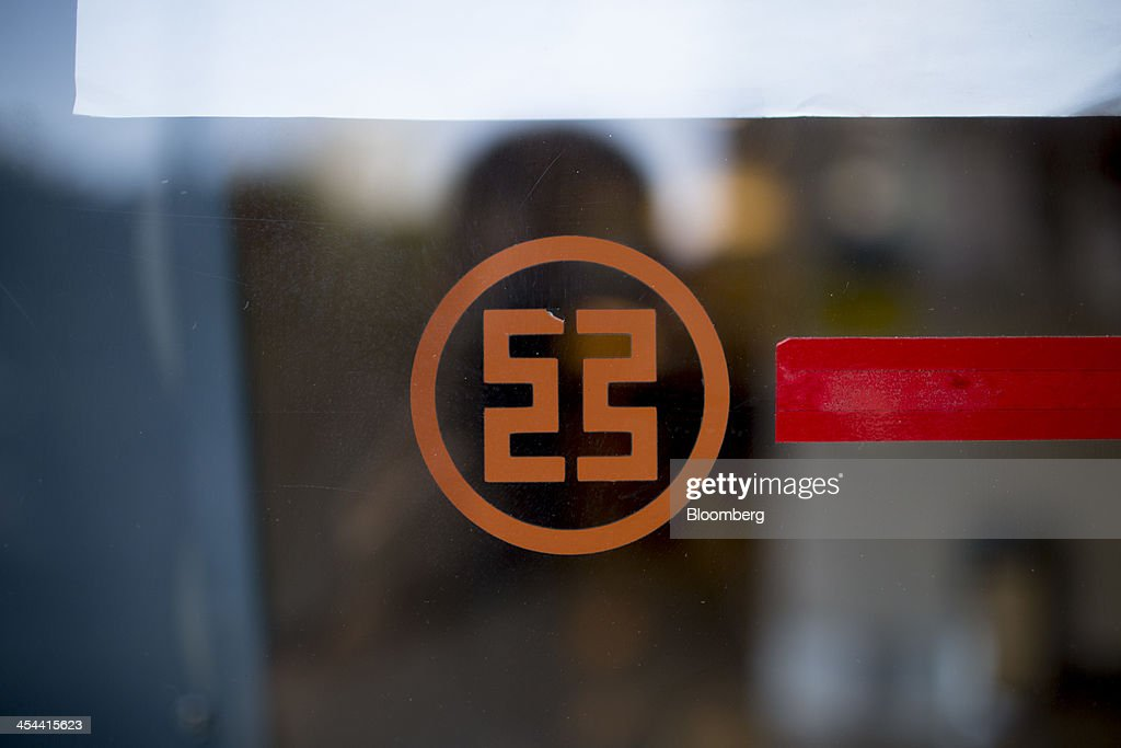 The logo for the Industrial & Commercial Bank of China Ltd. (ICBC) is displayed on a branch window in the Tianhe district of Guangzhou, Guangdong province, China, on Monday, Nov. 25, 2013. China is proposing the largest package of economic reforms since the 1990s to stoke growth in the worlds biggest emerging market. Photographer: Brent Lewin/Bloomberg via Getty Images