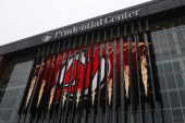 The logo for the National Hockey League's New Jersey Devils is displayed outside the team's home arena the Prudential Center in Newark New Jersey US...