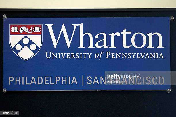 The logo for the University of Pennsylvania's Wharton School is displayed at the campus in San Francisco California US on Friday Feb 3 2012 The...