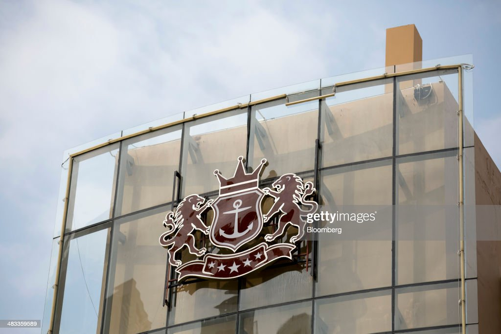 The logo for the Visun Royal Yacht Club is displayed atop the Visun Royal Yacht Hotel in the Sanya Bay district of Sanya, Hainan Province, China, on Monday, April 7, 2014. The yuan is poised to recover from declines that have made it Asia's worst-performing currency as China seeks to prevent an exodus of capital that would threaten economic growth, according to the most accurate forecasters. Photographer: Brent Lewin/Bloomberg via Getty Images