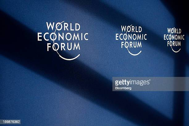 The logo for the World Economic Forum is seen on a wall in the media center in Davos Switzerland on Tuesday Jan 22 2013 World leaders Influential...