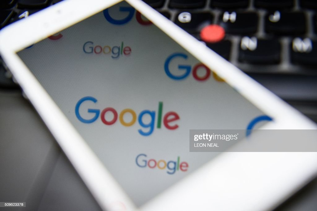 The logo for US technology company and search engine Google is displayed on screens in London on February 11, 2016. Britain's tax agency announced last month that Google would pay a £130 million (166 million euro, $187 million) tax settlement for 10 years' operations in Britain where it makes 11 percent of its global sales. Finance minister George Osborne hailed the agreement as a victory. But there was a barrage of criticism, including from within Prime Minister David Cameron's own Conservative Party as the announcement coincided with a key tax filing deadline for many Britons. NEAL