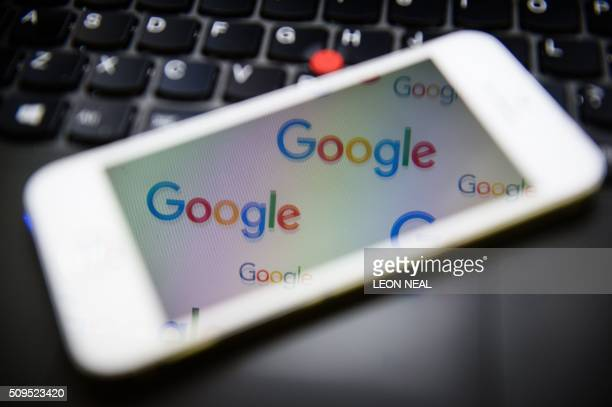 The logo for US technology company and search engine Google is displayed on screens in London on February 11 2016 Britain's tax agency announced last...