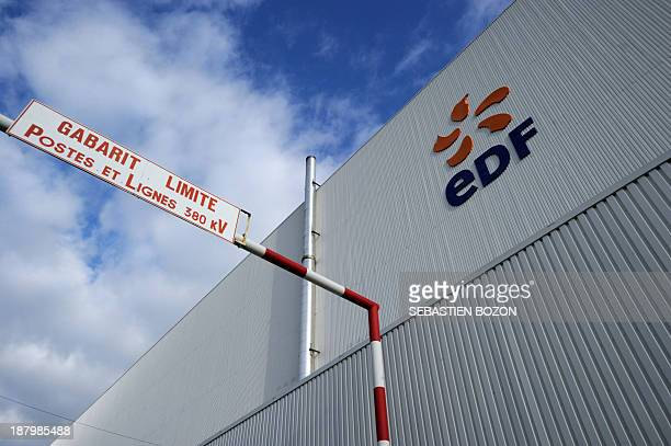 The logo of a French electric utility company is pictured on the facade of the Fessenheim nuclear powerplant during a nuclear accident simulation on...