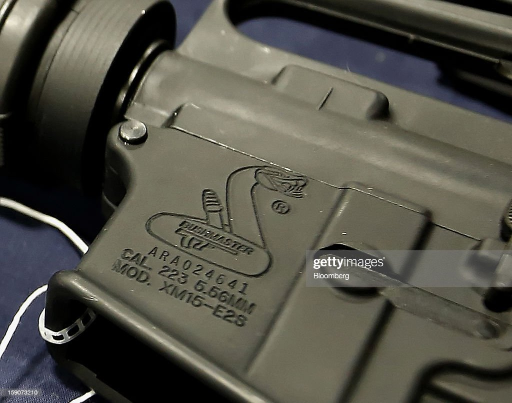 The logo of a semi-automatic assault rifle made by Bushmaster Firearms International LLC, displayed for sale at the Rocky Mountain Gun Show in Sandy, Utah, U.S., on Saturday, Jan. 5, 2013. A working group led by Vice President Joe Biden is seriously considering measures that would require universal background checks for firearm buyers, track the movement and sale of weapons through a national database, strengthen mental health checks and stiffen penalties for carrying guns near schools or giving them to minors. Photographer: George Frey/Bloomberg via Getty Images