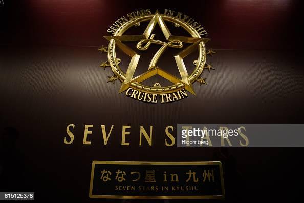 The logo of a Seven Stars in Kyushu luxury train operated by Kyushu Railway Co is displayed as it stops at Hakata Station in Fukuoka Fukuoka...