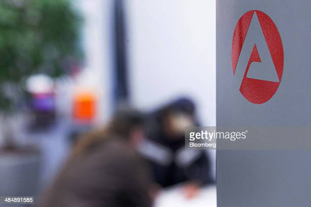 The logo of Agentur fuer Arbeit sits on a sign inside a employment office in Stuttgart Germany on Monday April 14 2014 German unemployment fell for a...