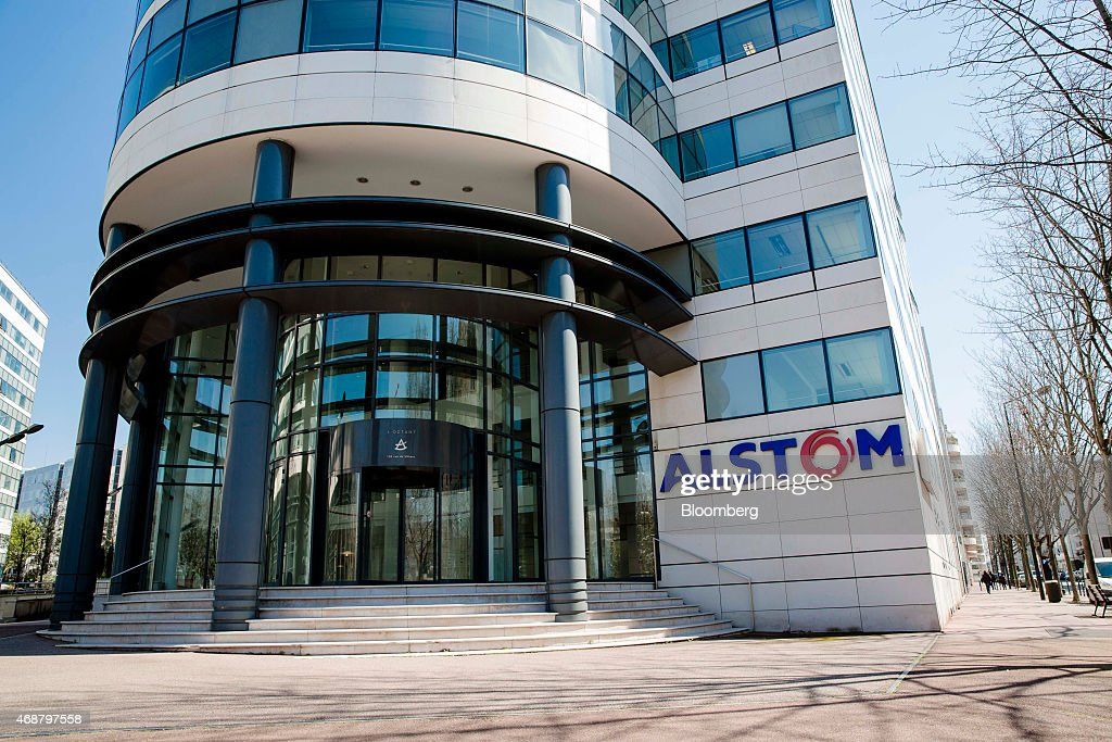 The logo of Alstom SA sits on display outside the company's headquarters in Paris France on Tuesday April 7 2015 Alstom is benefiting from France's...