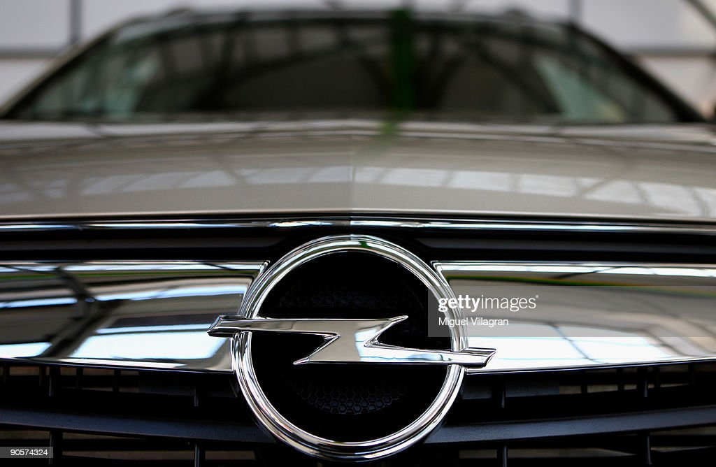 The logo of automaker Opel is pictured at an Opel car dealership on September 10 2009 in Munich Germany The carmaker announced that General Motors...