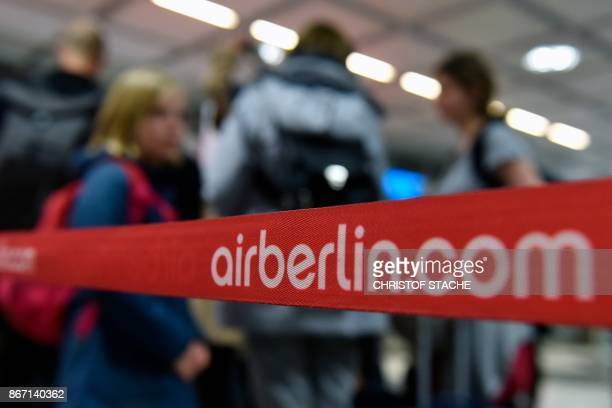 The logo of bankrupt German airline Air Berlin is seen as passengers check in for the airline's last scheduled flight at FranzJosefStrauss airport in...
