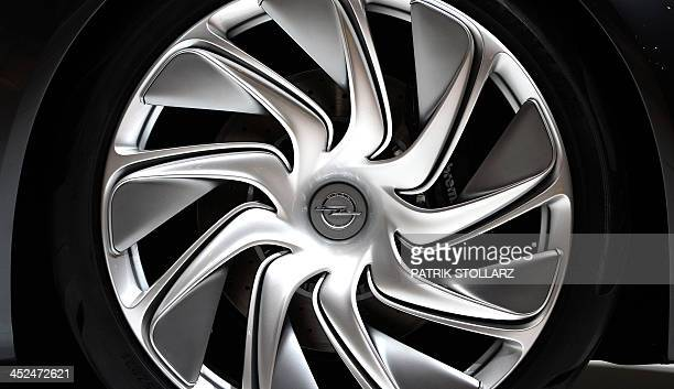 The logo of car maker Opel can be seen on the rim of the Opel Monza prototype on display at the Essen Motor Show on November 29 2013 at the fair...