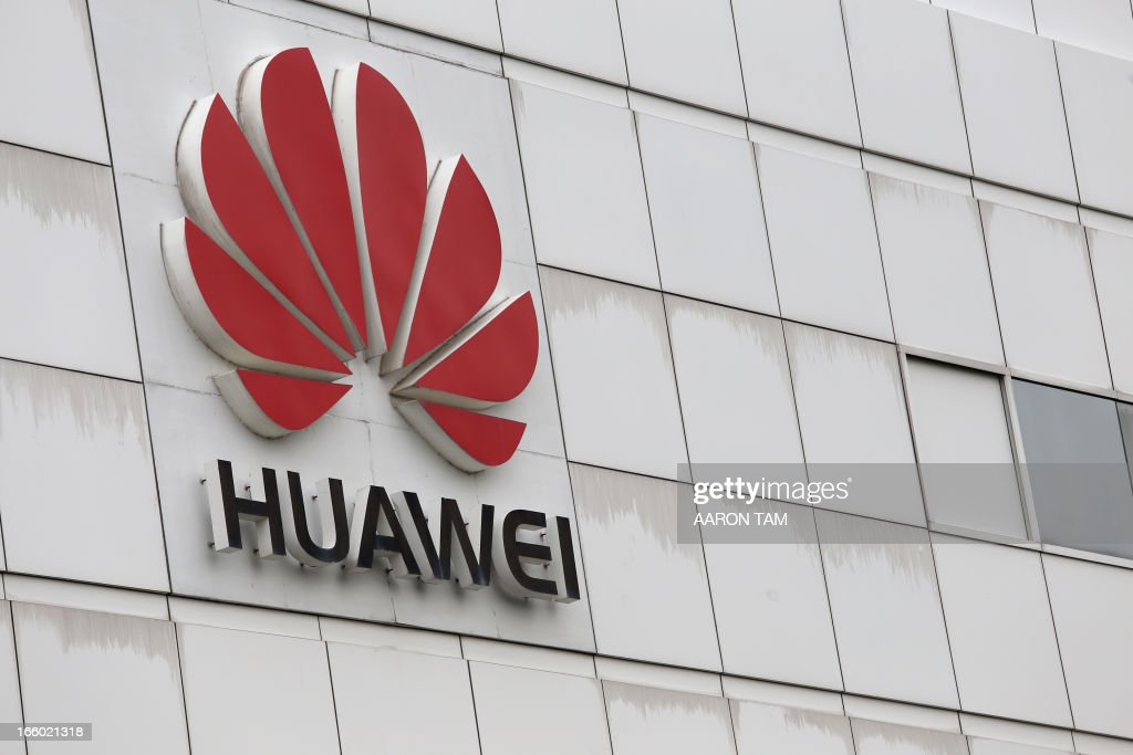 The logo of Chinese tech giant Huawei is seen on a building on its campus in the Chinese city of Shenzhen on April 7, 2013. Chinese tech giant Huawei said on April 8 that it hoped to 'solve the challenges and problems' it has in the United States after Washington labelled it a security threat last year. AFP PHOTO / AARON TAM
