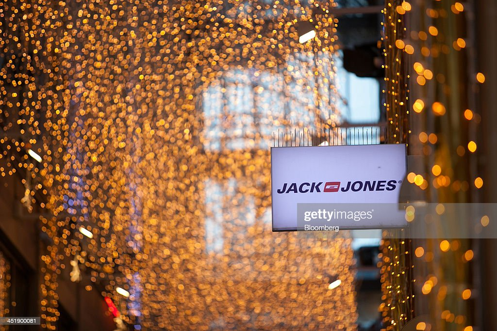 The logo of clothing retailer Jack & Jones AB sits on display as festive lights hang inside the Kaufingertor Passage shopping arcade in Munich, Germany, on Sunday, Nov. 24, 2013. In Germany, Europe's biggest economy, annual consumer prices increased 1.2 percent in October. Photographer: Krisztian Bocsi/Bloomberg via Getty Images