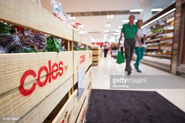 The logo of Coles supermarkets operated by Wesfarmers Ltd is displayed on the side of a crate inside an outlet in Sydney Australia on Tuesday Feb 18...