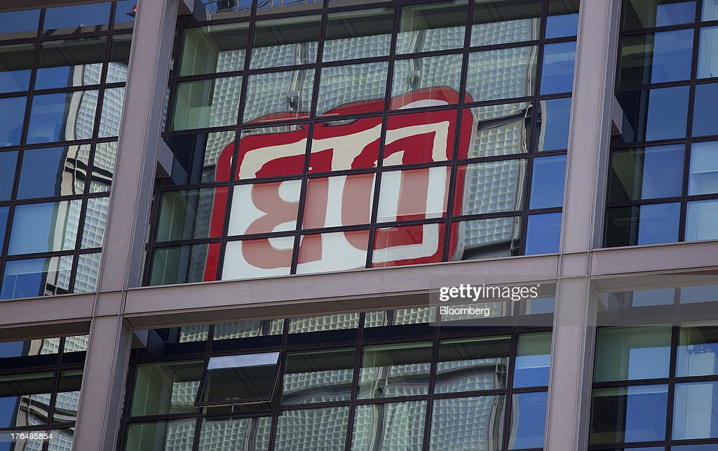 The logo of Deutsche Bahn AG is seen reflected in the windows of Berlin Central Station, also known as Hauptbahnhof, in Berlin, Germany, on Tuesday, Aug. 13, 2013. German gross domestic product rose 0.7 percent from the first quarter and the French economy expanded 0.5 percent, the countries' national statistics offices said today. Photographer: Krisztian Bocsi/Bloomberg via Getty Images