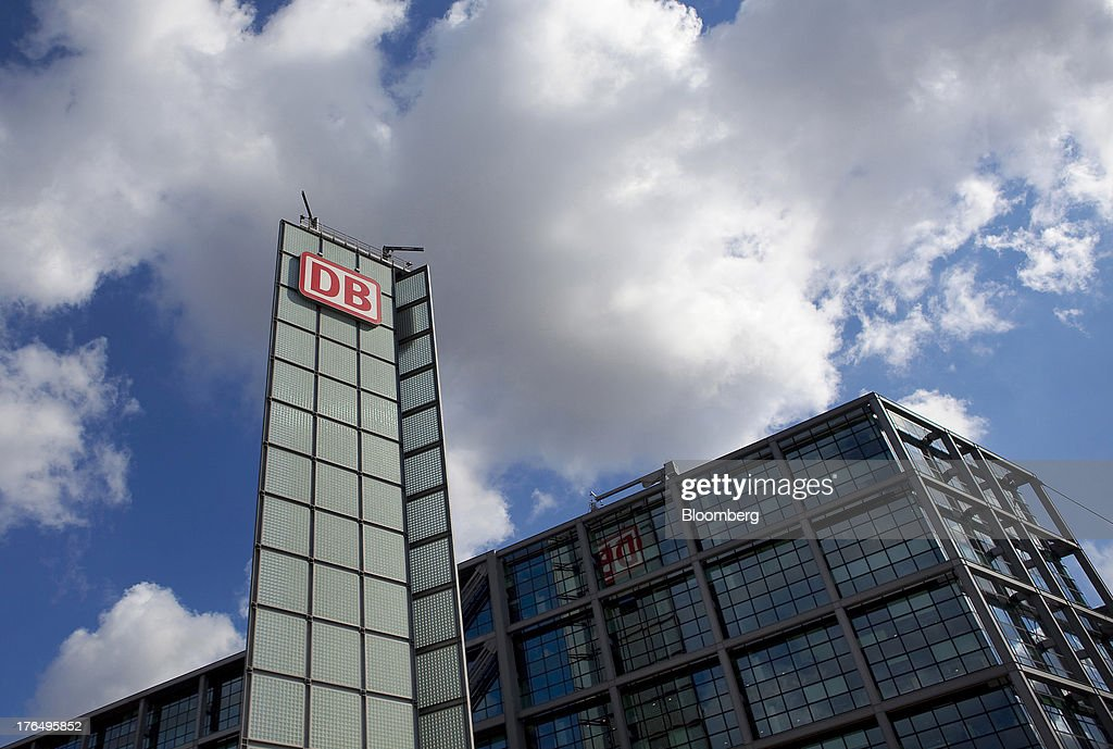 The logo of Deutsche Bahn AG sits on display outside Berlin Central Station, also known as Hauptbahnhof, in Berlin, Germany, on Tuesday, Aug. 13, 2013. German gross domestic product rose 0.7 percent from the first quarter and the French economy expanded 0.5 percent, the countries' national statistics offices said today. Photographer: Krisztian Bocsi/Bloomberg via Getty Images