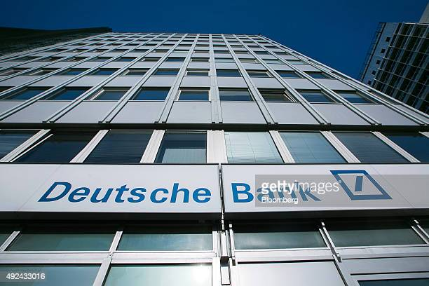 The logo of Deutsche Bank AG sits on the exterior of a bank branch in Berlin Germany on Monday Oct 12 2015 Deutsche Bank coChief Executive Officer...