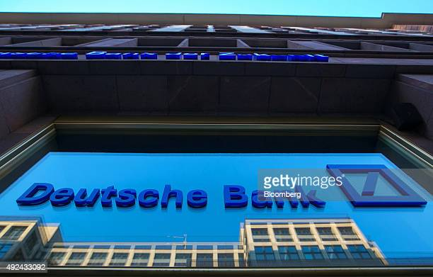 The logo of Deutsche Bank AG sits on the window of a branch of the bank in Berlin Germany on Monday Oct 12 2015 Deutsche Bank coChief Executive...