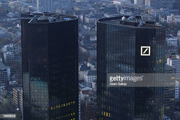The logo of Deutsche Bank Germany's largest bank is illuminated on one of the bank's twin towers December 1 2002 in Frankfurt Germany