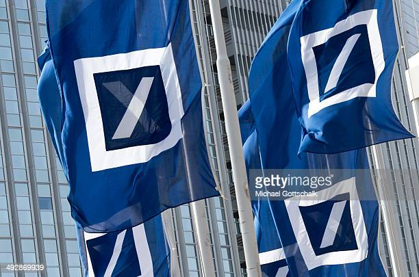 The logo of Deutsche Bank is seen on a flag during the annual general meeting of Deutsche Bank on May 22 2014 in Frankfurt Germany