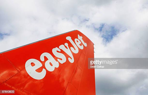The logo of discount airline Easyjet is written across the tail of one of the company's planes at Schoenefeld Airport May 17 2006 in Berlin Germany...