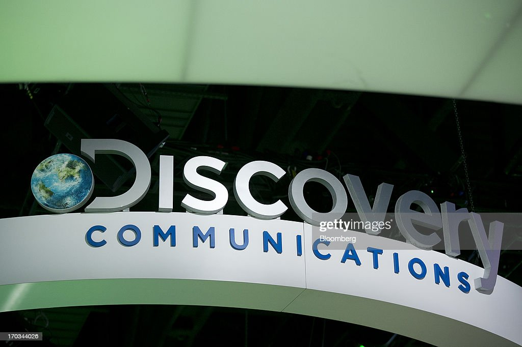 The logo of Discovery Communications Inc. is seen on the exhibit floor during the National Cable and Telecommunications Association (NCTA) Cable Show in Washington, D.C., U.S., on Tuesday, June 11, 2013. The Cable Show is expected to bring in more than 10,000 attendees with 286 companies on the exhibit floor. Photographer: Andrew Harrer/Bloomberg via Getty Images