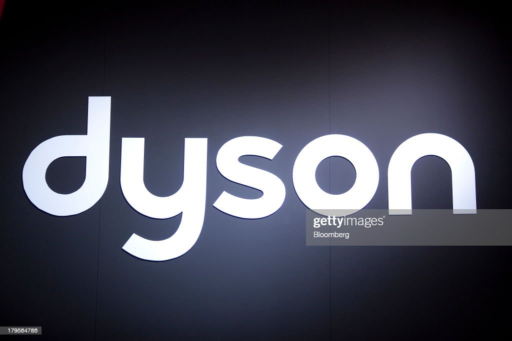 The logo of Dyson Ltd. sits on display at their stall on eve of the opening of the IFA consumer electronics show in Berlin, Germany, on Thursday, Sept. 5, 2013. Samsung showed the Galaxy Gear yesterday at IFA, Europe's largest consumer-electronics show, as it races Apple and Sony Corp. to carve a share of the market for wearable technology amid slowing growth in smartphones. Photographer: Krisztian Bocsi/Bloomberg via Getty Images