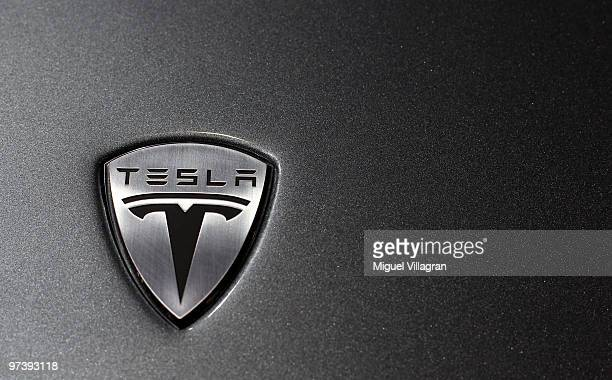 The logo of electric car manufacturer Tesla is pictured during the second press day at the 80th Geneva International Motor Show on March 3 2010 in...