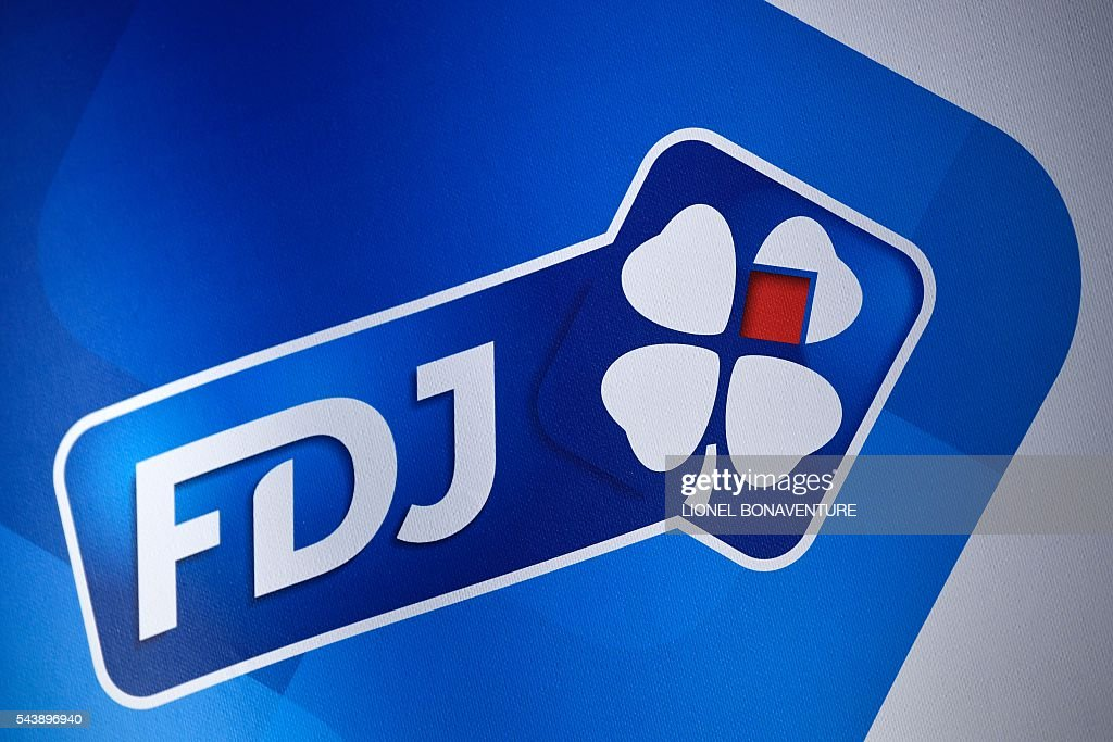 The logo of France's FDJ cycling team is pictured at the press center in Saint-Lo, on July 30, 2016, two days before the start of the 103rd edition of the Tour de France cycling race. The 2016 Tour de France will start on July 2 in the streets of Le Mont-Saint-Michel and ends on July 24, 2016 down the Champs-Elysees in Paris. / AFP / LIONEL