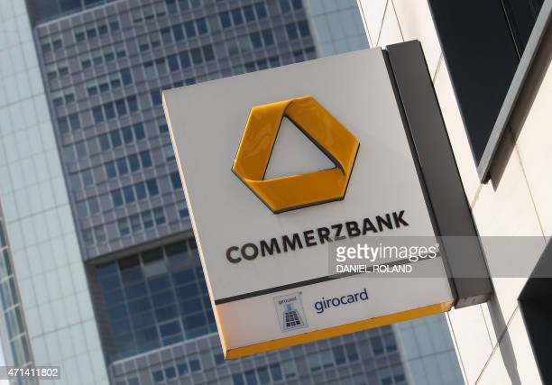 The logo of German bank Commerzbank can be seen in front of the company's headquarters in Frankfurt am Main western Germany on April 28 2015...