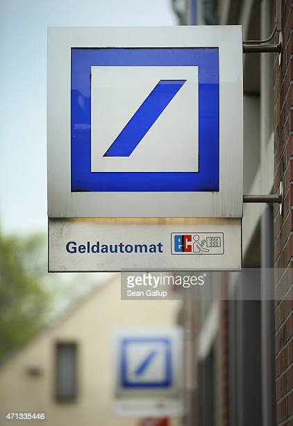 The logo of German bank Deutsche Bank hangs over one of the bank's branches on April 27 2015 in Berlin Germany Deutsche Bank announced earlier in the...