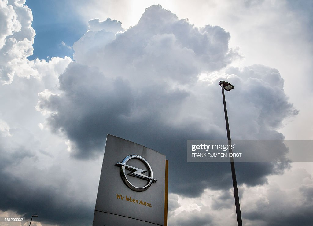 The logo of German car maker Opel can be seen in front of the company's plant in Ruesselsheim western Germany on May 13 2016 Opel is facing...