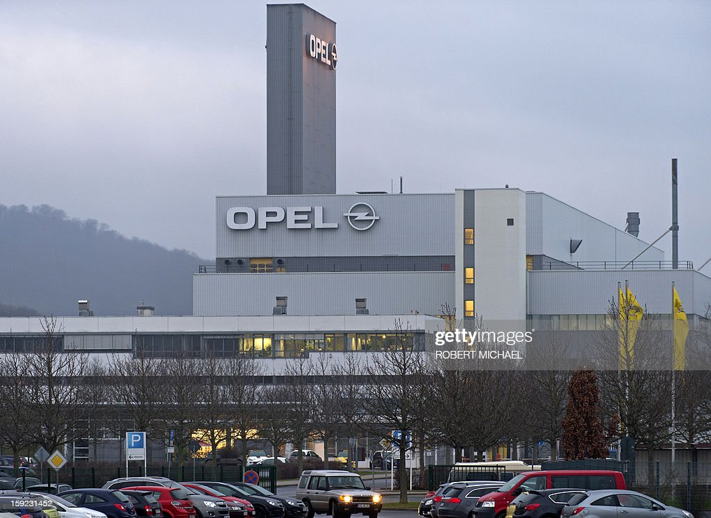 The logo of German car maker Opel decorates the outside of the plant in Eisenach, eastern Germany , on January 10, 2013, where the new Opel Adam is produced. The new model is intended to attract young automobile drivers in cities. Opel has already received 16 000 orders for the Adam. AFP PHOTO / ROBERT MICHAEL
