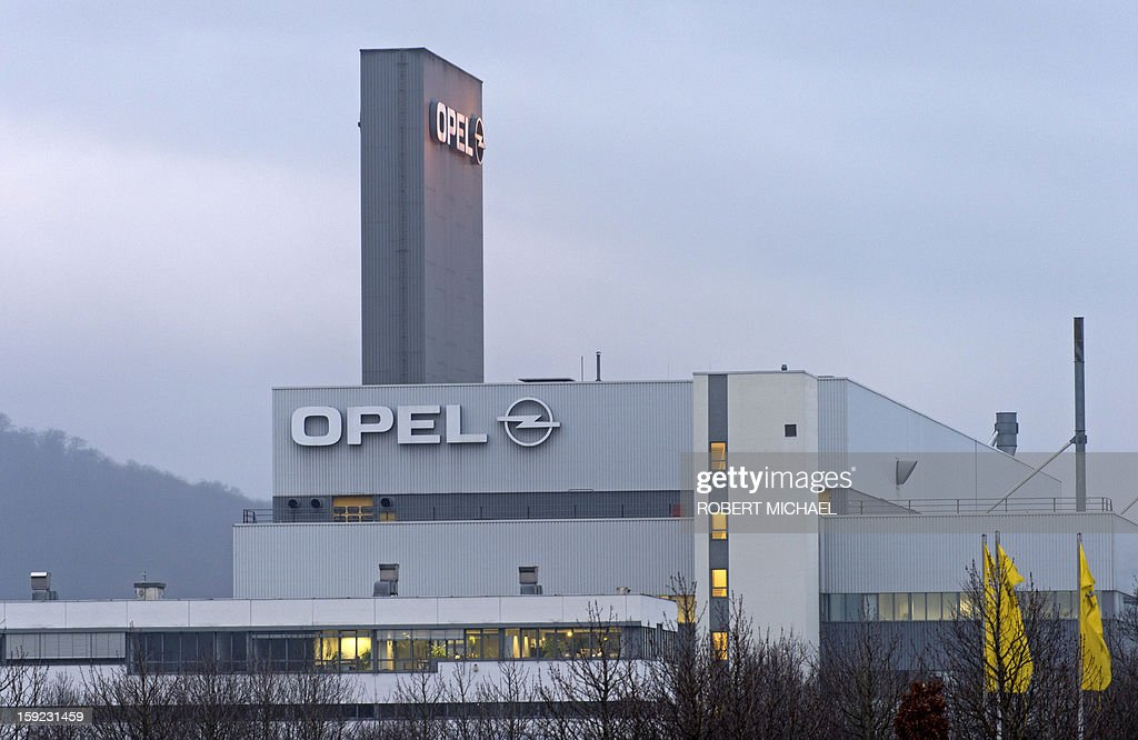 The logo of German car maker Opel decorates the outside of the plant in Eisenach, eastern Germany , on January 10, 2013, where the new Opel Adam is produced. The new model is intended to attract young automobile drivers in cities. Opel has already received 16 000 orders for the Adam.