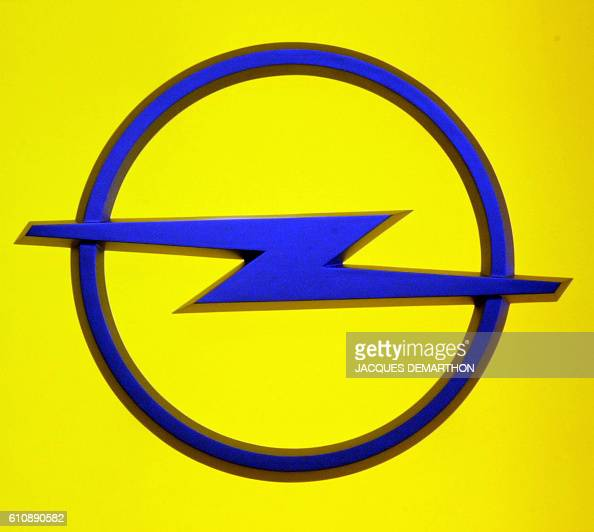 the logo of german car maker opel is pictured 27 september 2002 at the paris auto show pictures. Black Bedroom Furniture Sets. Home Design Ideas