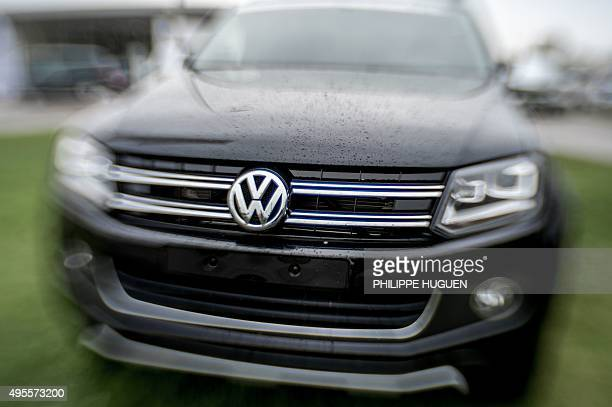 The logo of German car maker Volkswagen is pictured onto a car at a sales branch and garage in Dunkerque northern France on November 4 2015 Shares in...