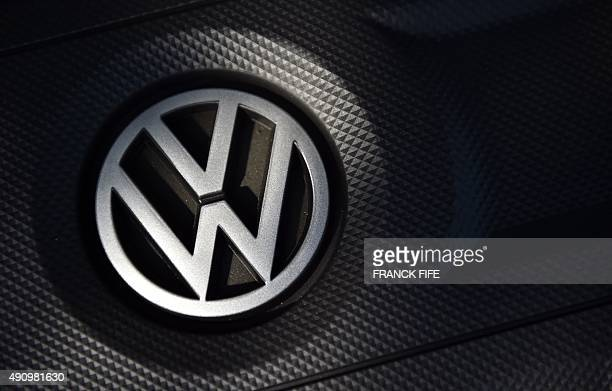 The logo of German car maker Volkswagen is seen on a VW Golf car in Milton Keynes north of London on October 2 2015 Paris prosecutors have launched a...