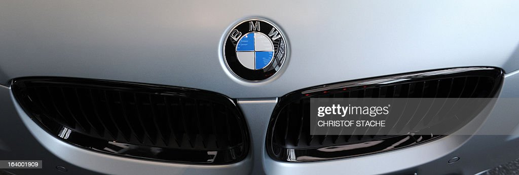 The logo of German carmaker BMW is seen on a car displayed during the annual results press conference in Munich, southern Germany, on March 19, 2013. German top-of-the-range carmaker BMW said today it is 'cautiously optimistic' for business in 2013 after achieving the best year in the company's history last year. STACHE