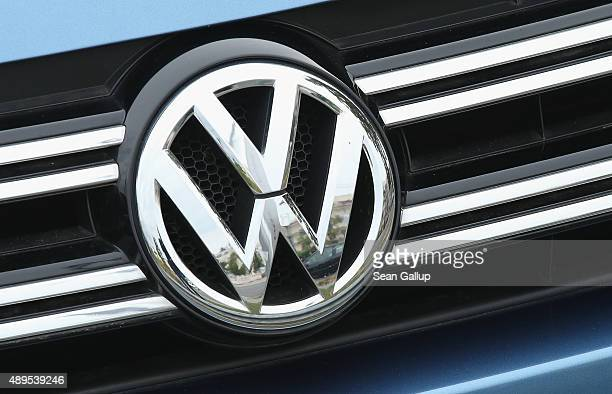 The logo of German carmaker Volkswagen is visible on the front of a Volkswagen car on September 22 2015 in Berlin Germany Volkswagen CEO Martin...